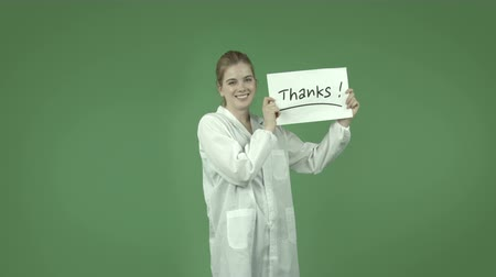 ação de graças : attractive caucasian girl wearing a lab coat isolated on chroma green background