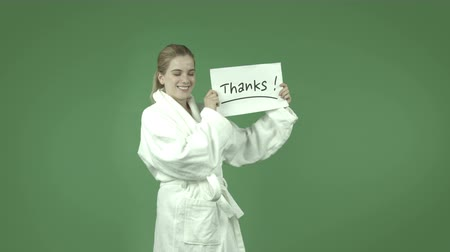 ação de graças : attractive caucasian girl wearing a bathrobe  isolated on chroma green background