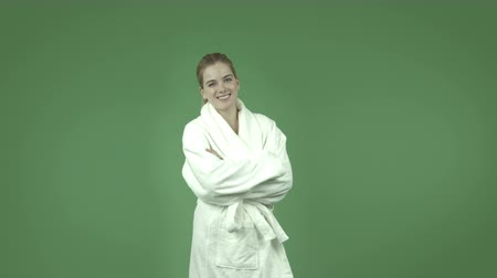 седые волосы : attractive caucasian girl wearing a bathrobe  isolated on chroma green background