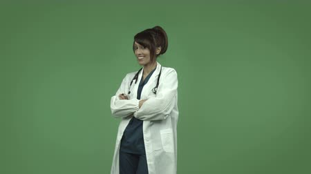 general practitioner : indian female doctor isolated on greenscreen chroma green background