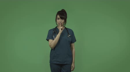 cisza : indian female doctor isolated on greenscreen chroma green background