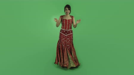 indian ethnicity : woman in traditional indian outfit isolated on greenscreen chroma green background Stock Footage