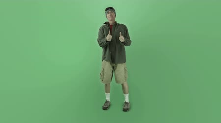 chroma key background : Senior caucasian man isolated on a green screen Stock Footage