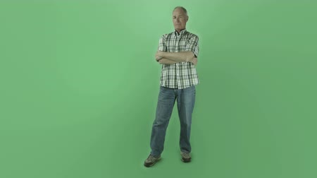 kaukázusi : Senior caucasian man isolated on a green screen Stock mozgókép