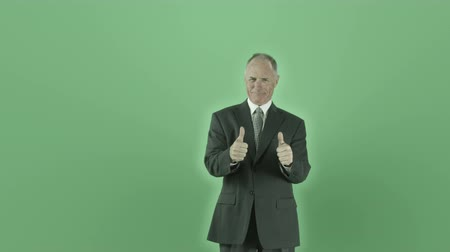felnőtt : Senior caucasian man isolated on a green screen Stock mozgókép