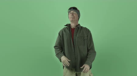 welcome sign : Senior caucasian man isolated on a green screen Stock Footage