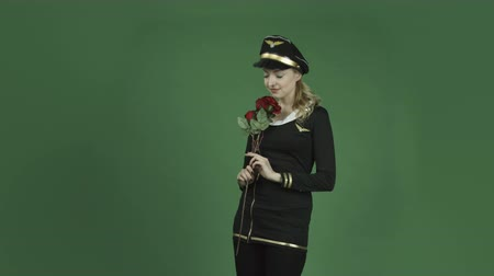 miłość : caucasian air hostess isolated on chroma green screen background