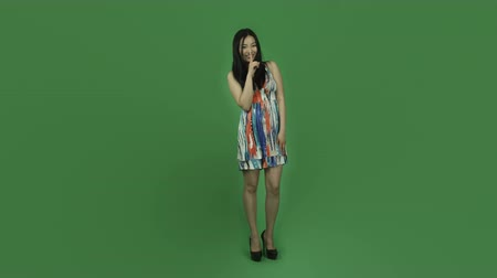 évad : Attractive asian girl in her 20s isolated on a greenscreen chroma green background Stock mozgókép