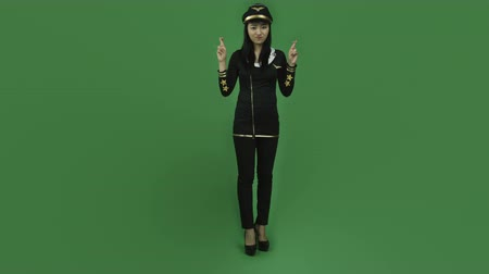 piloto : Attractive asian girl in her 20s isolated on a greenscreen chroma green background Vídeos