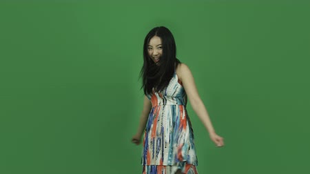 komik : Attractive asian girl in her 20s isolated on a greenscreen chroma green background Stok Video