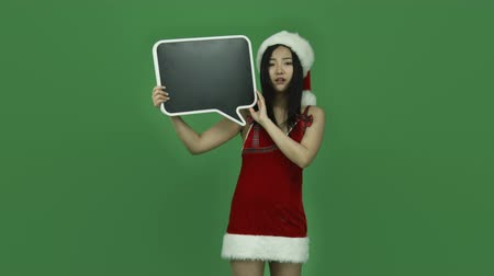 świety mikołaj : Attractive asian girl in her 20s isolated on a greenscreen chroma green background Wideo