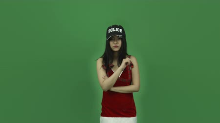 insan parmak : Attractive asian girl in her 20s isolated on a greenscreen chroma green background Stok Video