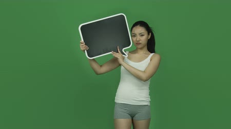 серый фон : Attractive asian girl in her 20s isolated on a greenscreen chroma green background Стоковые видеозаписи
