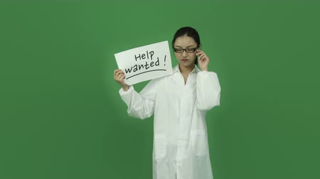 felnőtt : Attractive asian girl in her 20s isolated on a greenscreen chroma green background Stock mozgókép