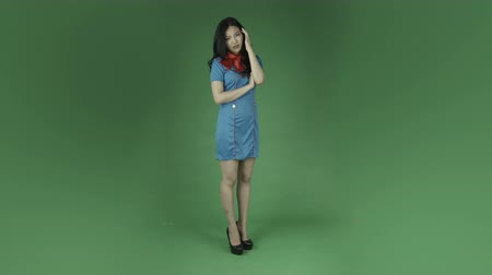 ekran : air hostess young asian adult woman isolated on green-screen background Wideo