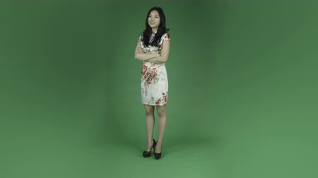 тайна : young asian adult woman isolated on green-screen background traditional chinese dress