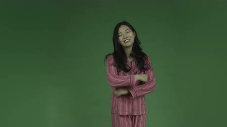 insan parmak : young asian adult woman in pajamas isolated on green-screen background