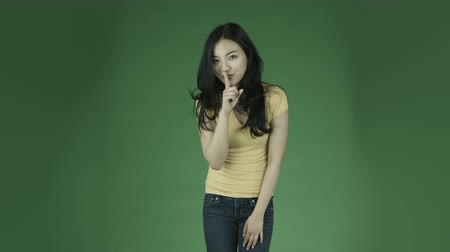 cisza : casual young asian adult woman isolated on green-screen background