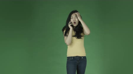 öfke : casual young asian adult woman isolated on green-screen background