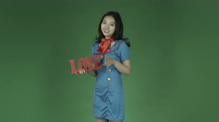 em pé : air hostess young asian adult woman isolated on green-screen background Vídeos