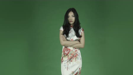 tradicional : young asian adult woman isolated on green-screen background traditional chinese dress