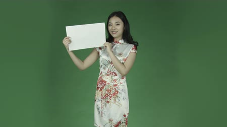 ruha : young asian adult woman isolated on green-screen background traditional chinese dress