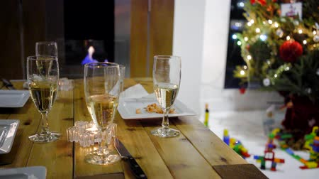 sparkling wine champagne in front of chimney during christmas with tree Dostupné videozáznamy