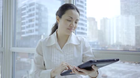 touchpad : Happy Model woman using technology device indoor home cellphone tablet computer Stock Footage