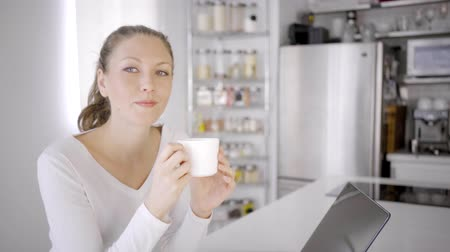 caucasian woman indoor modern house city lifestyle technology with coffee