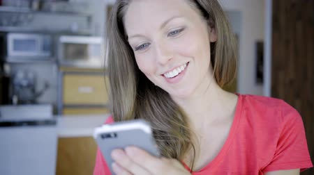 caucasian woman indoor modern house online with cellphone