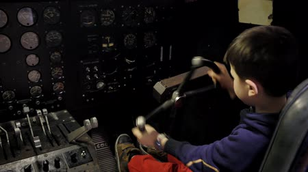 bitola : kid driving inside a plane pilot with a the instruments