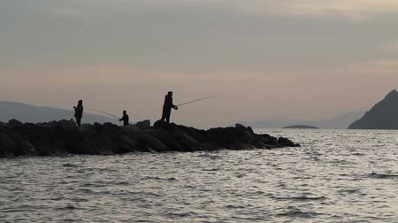 Fisherman by the sea