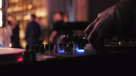 gramophone : DJ plays vinyl turntables. In a nightclub - bar. The vinyl record is spinning. Stock Footage