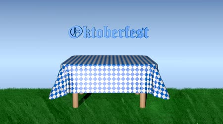 Table with blue and white checkered blanket, on which the lettering Oktoberfest if in German Dostupné videozáznamy