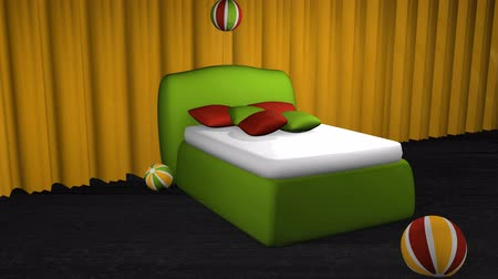 Green boxspring bed with bouncing balls on black carpet floor in front of a yellow curtain