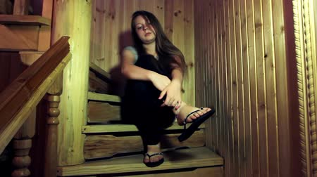 полный : nice teen girl sits on wooden stairs in home