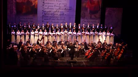 ato : DNIPRO, UKRAINE - MARCH 10, 2018: Caucasus - Cantata symphony for choir and symphony orchestra by S.Lyudkevych performed by members of the Dnipro Opera and Ballet Theater - conductor Nazar Yatskiv.