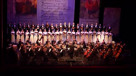 felvonás : DNIPRO, UKRAINE - MARCH 10, 2018: Caucasus - Cantata symphony for choir and symphony orchestra by S.Lyudkevych performed by members of the Dnipro Opera and Ballet Theater - conductor Nazar Yatskiv.