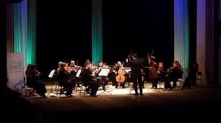 dyrygent : DNIPRO, UKRAINE - MARCH 12, 2018: FOUR SEASONS Chamber Orchestra - main conductor Dmitry Logvin perform Concerto Grosso op.6, No.4 by Arcangelo Corelli at the State Drama Theater.