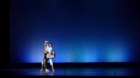 senfoni : DNIPRO, UKRAINE - MARCH 23, 2018: Famous dancers Kateryna Kuhar and Olexander Stoyanov perform Simple things at the Dnipro State Opera and Ballet Theater. Stok Video