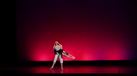 heykelcik : DNIPRO, UKRAINE - MARCH 23, 2018: Famous dancers Kateryna Kuhar and Olexander Stoyanov perform Simple things at the Dnipro State Opera and Ballet Theater. Stok Video