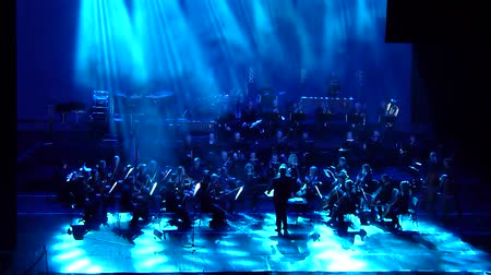 akt : DNIPRO, UKRAINE - FEBRUARY 11, 2018: Symphonyic Show performed by members of the Dnipro Opera and Ballet Theater - conductor Yuri Porohovnik. Dostupné videozáznamy
