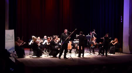 clarinet : DNIPRO, UKRAINE - JUNE 18, 2018: FOUR SEASONS Chamber Orchestra - main conductor Dmitry Logvin perform Concertino by Franz Danzi for clarinet and bassoon with the theater at the State Drama Theater.