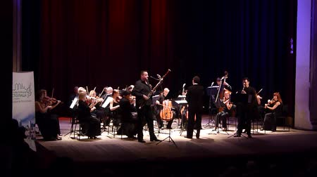 hangjegykulcs : DNIPRO, UKRAINE - JUNE 18, 2018: FOUR SEASONS Chamber Orchestra - main conductor Dmitry Logvin perform Concertino by Franz Danzi for clarinet and bassoon with the theater at the State Drama Theater.