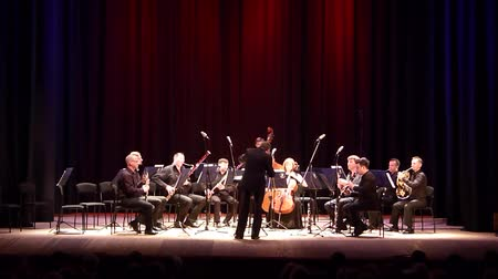 clarinet : DNIPRO, UKRAINE - JUNE 18, 2018: FOUR SEASONS Chamber Orchestra - main conductor Dmitry Logvin perform Serenade by Antonin Dvorak at the State Drama Theater. Stock Footage