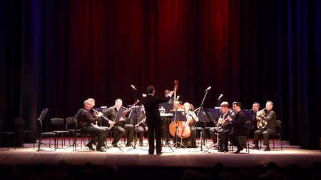 hangjegykulcs : DNIPRO, UKRAINE - JUNE 18, 2018: FOUR SEASONS Chamber Orchestra - main conductor Dmitry Logvin perform Serenade by Antonin Dvorak at the State Drama Theater. Stock mozgókép