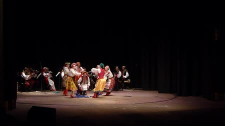 театр : DNIPRO, UKRAINE - NOVEMBER 7, 2018: National traditions, customs and rites of the Ukrainian people performed by members of the Folklore Ensemble SLAVUTYCH at the State Drama Theatre.