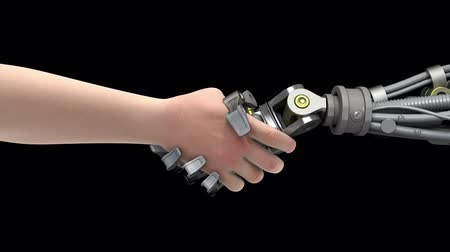 robots : Shake hands with a robot. Black background. Stock Footage