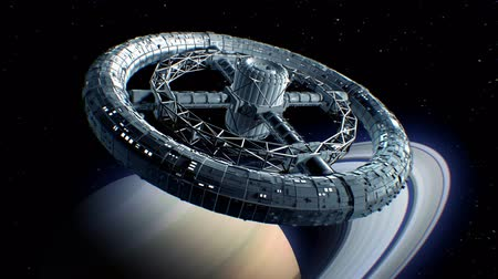 Circular space station. Giant sci-fi torus rotate on Saturn background, 3d animation. Texture of the Planet was created in the graphic editor without photos and other images. Stok Video