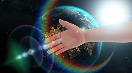 intelligencia : Handshake with robot, 3d animation concept in space on Earth background. Textures of Planet were created in graphic editor without photos. Pattern of city lights furnished by NASA. Stock mozgókép